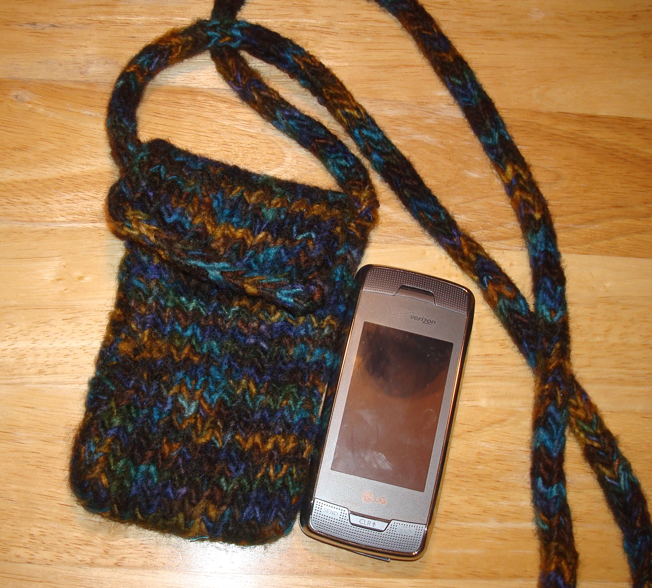 I knitted and hand-felted this little pouch for my cell phone.