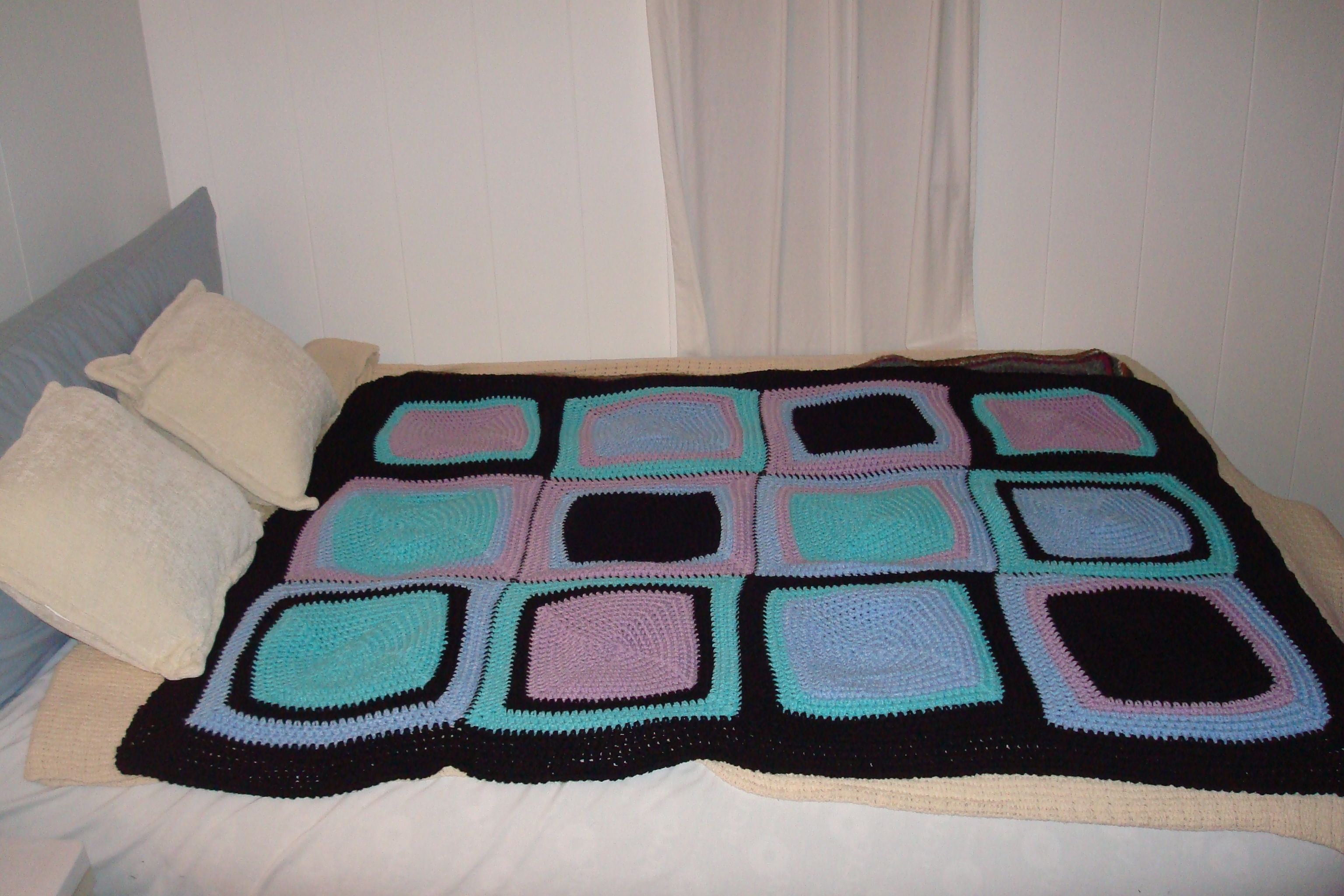 This turquoise, rose and black version of Vanna's Choice Squared Afghan is for my daughter.