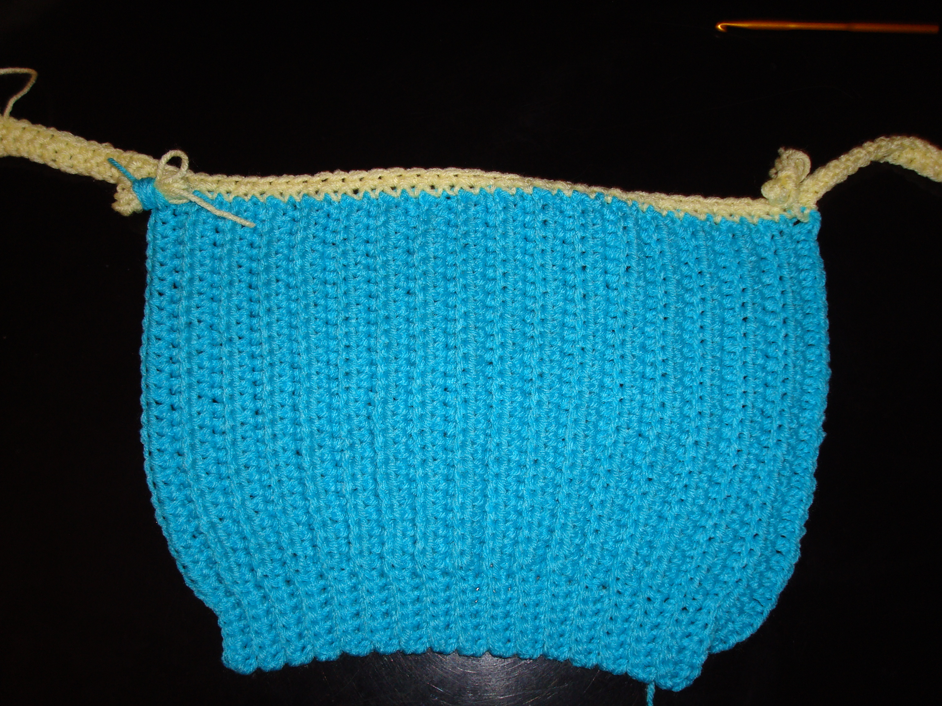 The bottom half of my version of the Knit for Kids sweater is crocheted vertically.