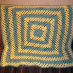 """The upper right corners of the granny square dip down or """"tilt"""" or """"lean."""""""