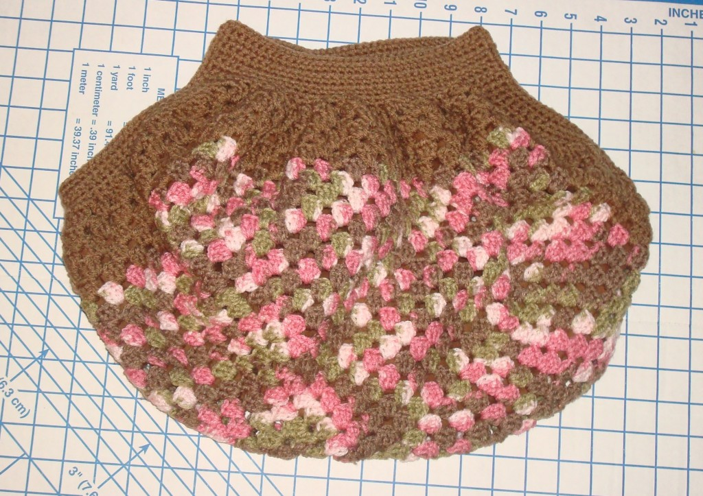 Tops and sides are added to lined granny square.